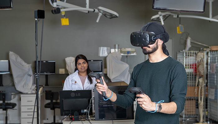 McMaster University students Jaskaran Gill (wearing headset) and Akanksha Aggarwal inside the anatomy lab using virtual reality technology.